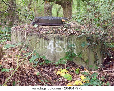 close up of numbered war bunker locked top forest