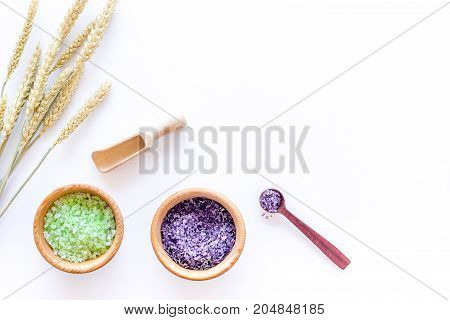natural cosmetics with wheat and herbs for homemade spa on stone table background top view mock up