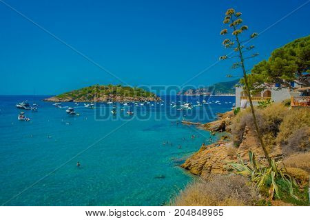 Beautiful sunny day in Sant Elm, with a beautiful blue water in Majorca, with people enjoying the weather, in Spain.