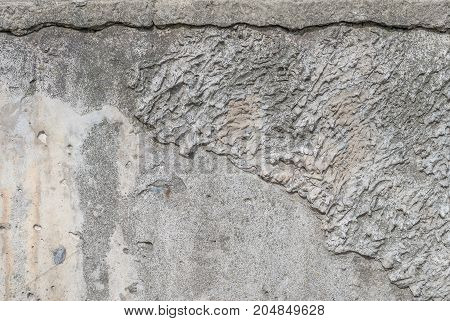 old chipped plaster on the concrete wall, abstract concrete, grey texture, background
