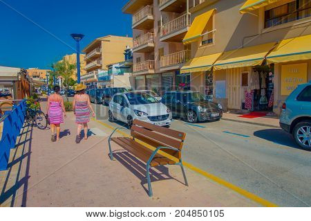 PORT D ANDRATX, SPAIN - AUGUST 18 2017: Unidentified people walking at outdoor the street in Port d Andratrx, Spain.
