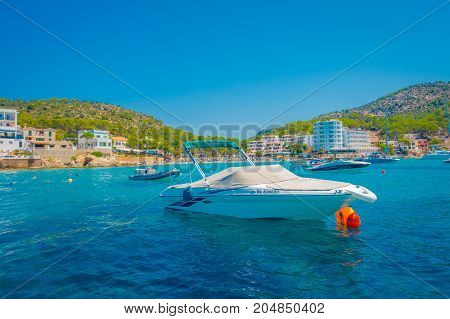 SANT ELM, MAJORCA, SPAIN - AUGUST 18 2017: Nice boat in Sant Elm, in a beautiful blue water and sky in Majorca, Spain.