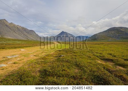 the Subpolar Urals with views of the mountains. Hiking. August 2017