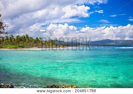 Caribbean sea surface summer wave background. Exotic water landscape with clouds on horizon. Dominican Republic nature relax. Travel tropical island resort. Ocean nature tranquility
