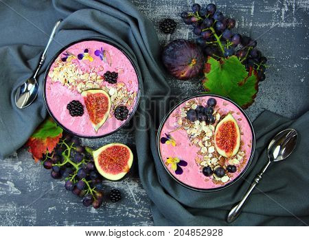 smoothies in a round bowl with figs,blackberries and grapes.healthy Breakfast