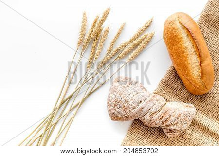 bakery shop set with fresh wheaten bread on table white background top view mock up
