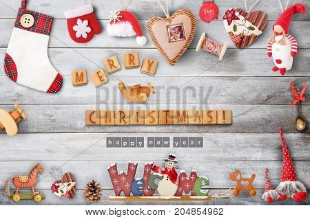 Christmas Greeting Card with Xmas Elements and Toys on Gray Wooden Background. Retro Style.