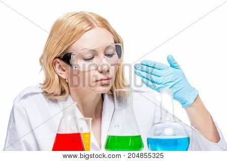 Portrait Of An Experienced Chemist With Multi-colored Substances In Test Tubes On A White Background