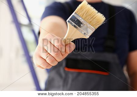 Arm Of Smiling Worker Hold Brush Closeup