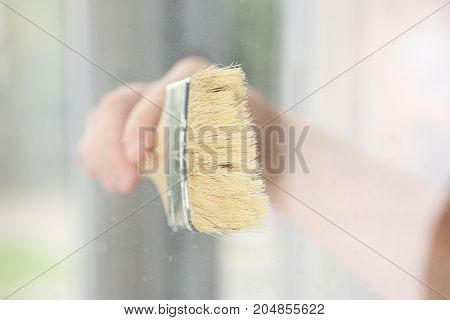 Arm Of Worker Hold Brush Closeup