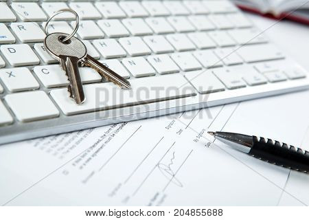 apartment keys mortgage loan document and a keyboard