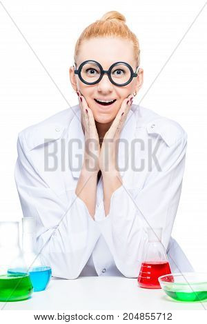 Portrait Of A Joyful Chemist In Funny Glasses With Test Tubes