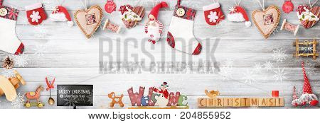 Christmas Greeting Hero Image with Xmas Elements and Toys on Gray Wooden Background. Retro Style.