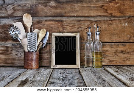 Kitchen Still Life. Kitchen Utensils In A Stand Near The Wooden Wall.kitchen Tools, Wooden Frame Wit