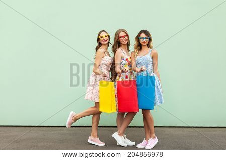Attractive Happy Customers In Glasses With Packets After Shopping.