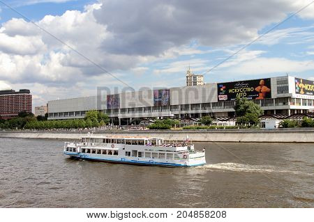 Moscow Russia - July 20 2017: White pleasure boat sails along the Moscow River.