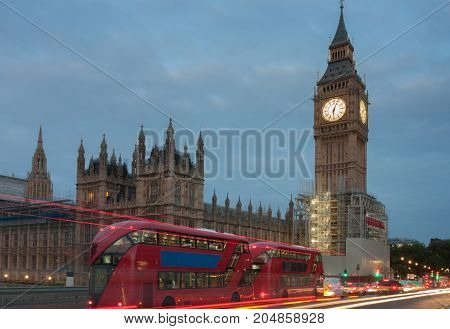Double decker buses on westminster bridge Big Ben and Palace of Westminster in the morning London, England.