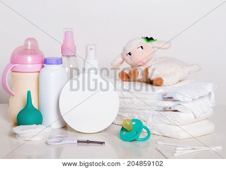accessories for a newborn baby - everything you need to care for inadequate - bathroom accessories. a bottle of milk. a toy. diapers.