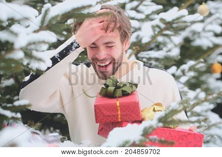 Man Laughing With Red Boxes In Snow Wood
