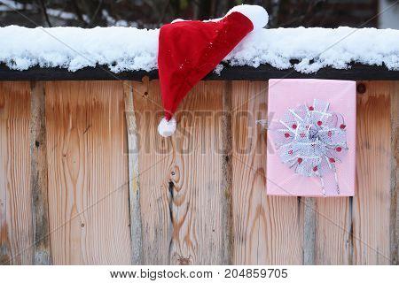 Santa Presents On Snowy Fence