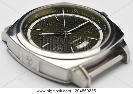 wintage silver green auto watch with white background