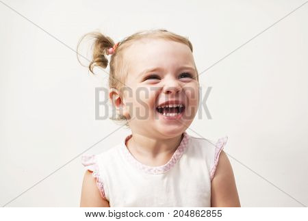 Beautiful expressive adorable happy cute laughing smiling baby infant face , isolated.