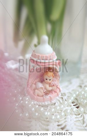 decor baby girl statue for baby shower. pink bottle with girl