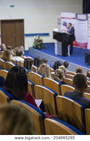 Business Concepts. Male Host Speaking On Stage During Business Conference in Large Congress Hall. Ideas Entrepreneurship. Vertical Image Orientation