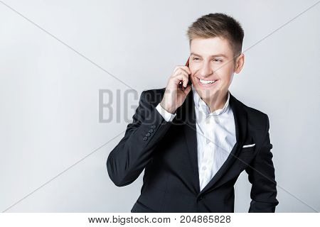 elegant successful Business man in suit talking on the phone