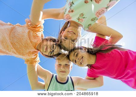 A Group of child have fun on a field hand high