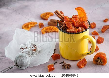 Pumpkin candy halloween sweets in yellow cup.