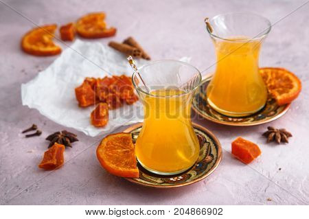 Sea buckthorn tea with honey and candied fruits.