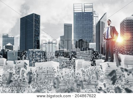 Young confident businessman in suit standing among flying letters with cityscape and sunlight on background. Mixed media.