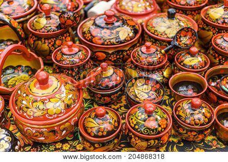 Russian wooden utensils. Khokhloma or Hohloma, traditional Russian handmade souvenir, selective focus