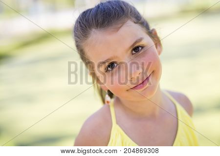 A Portrait of a little girl on a yellow background. Girl nine years.