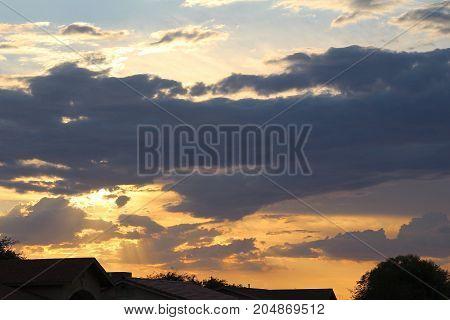 Puffy white clouds in bright blue sky