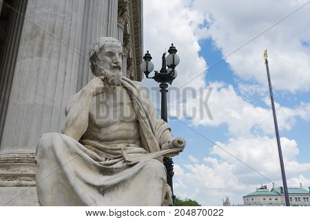 Statue of Herodot in front of Austrian Parliament building on Ringstrasse in Vienna Austria