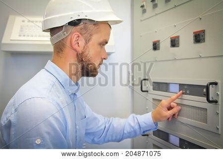 electrical engineer for automation configures industrial controller
