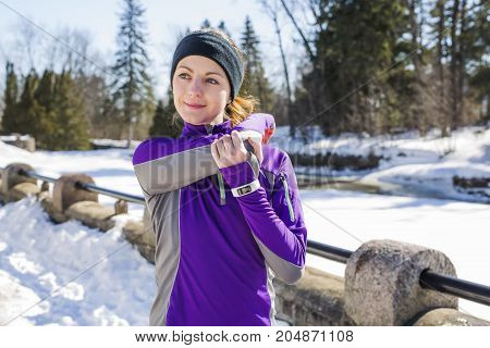 A Winter running exercise woman in snow
