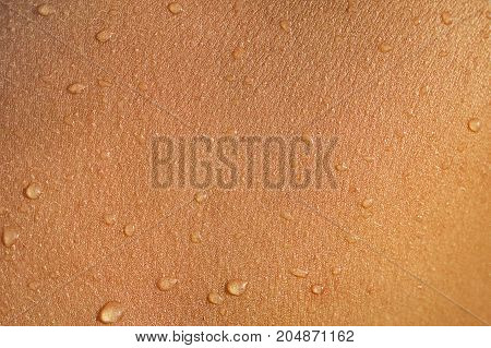 Dark skin of woman macro. Human skin texture background with drops. Wet skin close-up