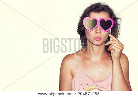 Beauty Young fashion model Girl with Valentine heart paper glasses. Love. Valentines Day gift. isolated on white background