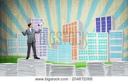 Businessman in suit standing on pile of documents with speaker in hand with sketched cityscape view on background. Mixed media.