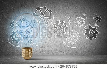 Lightbulb with multiple sketched gears inside placed against sketched gear mechanism on grey wall on background. 3D rendering.