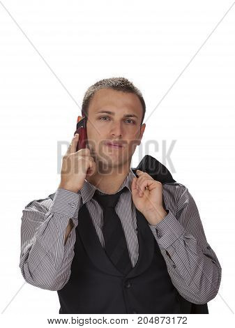 Serious young businessman on the phone isolated against a white background.