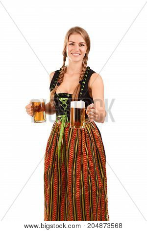 Smiling female in German dress holding a glass beer mug. Oktoberfest concept.