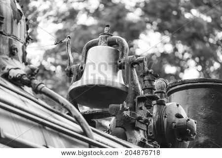 Vintage bell on an old fashioned steam locomative train black and white image