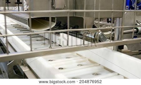 Food factory automated robotic machine. Conveyor product line for cooking and packing rations and food packs. Robotics and automatic lines used instead of human labor on factories and plants. poster