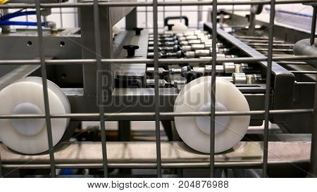 Food factory automated robotic production machine. Conveyor product line for cooking and packing rations and foods. Robotics and automatic lines used instead of human labor on factories and plants.