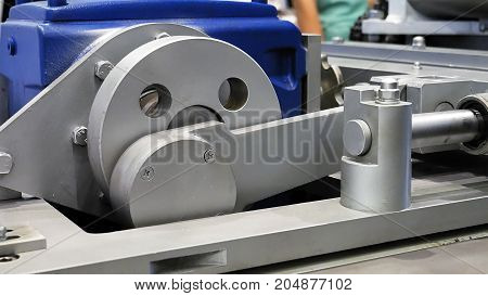 Crank drive gear wheel the part of industrial factory machine. Automated robotic production machinery.