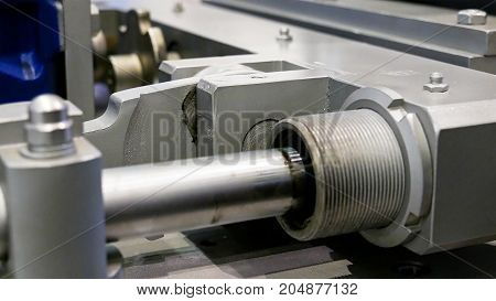 Crank drive gear of industrial factory machine. Automated robotic production machinery.